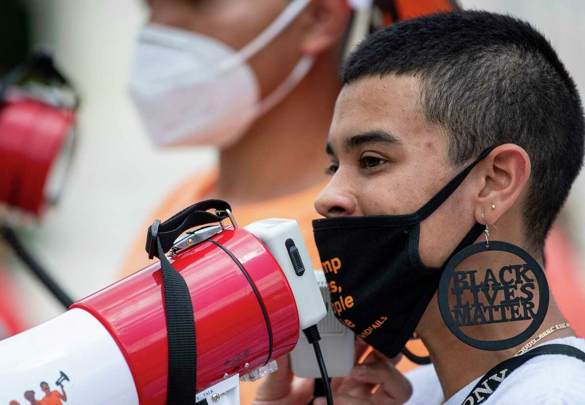 Undocumented immigrant Gaby Hernandez addresses demonstrators at a rally outside the Supreme Court on Thursday.