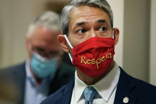 Mayor Ron Nirenberg wears a mask with the word 'respect' on it on Thursday, June 18, 2020. The Mayor is calling on CPS Energy's board of trustees to release a report detailing the cost to close the Spruce coal plant.