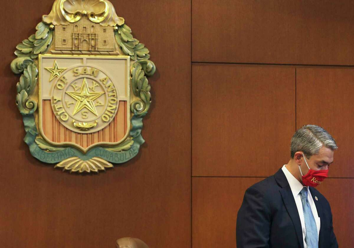 """Mayor Ron Nirenberg wears a mask with the word, """"respect"""" as San Antonio City Council gets its first look at next year's budget on Thursday. Budget officials are looking at cuts in next year's budget caused by economic fallout of the coronavirus pandemic."""