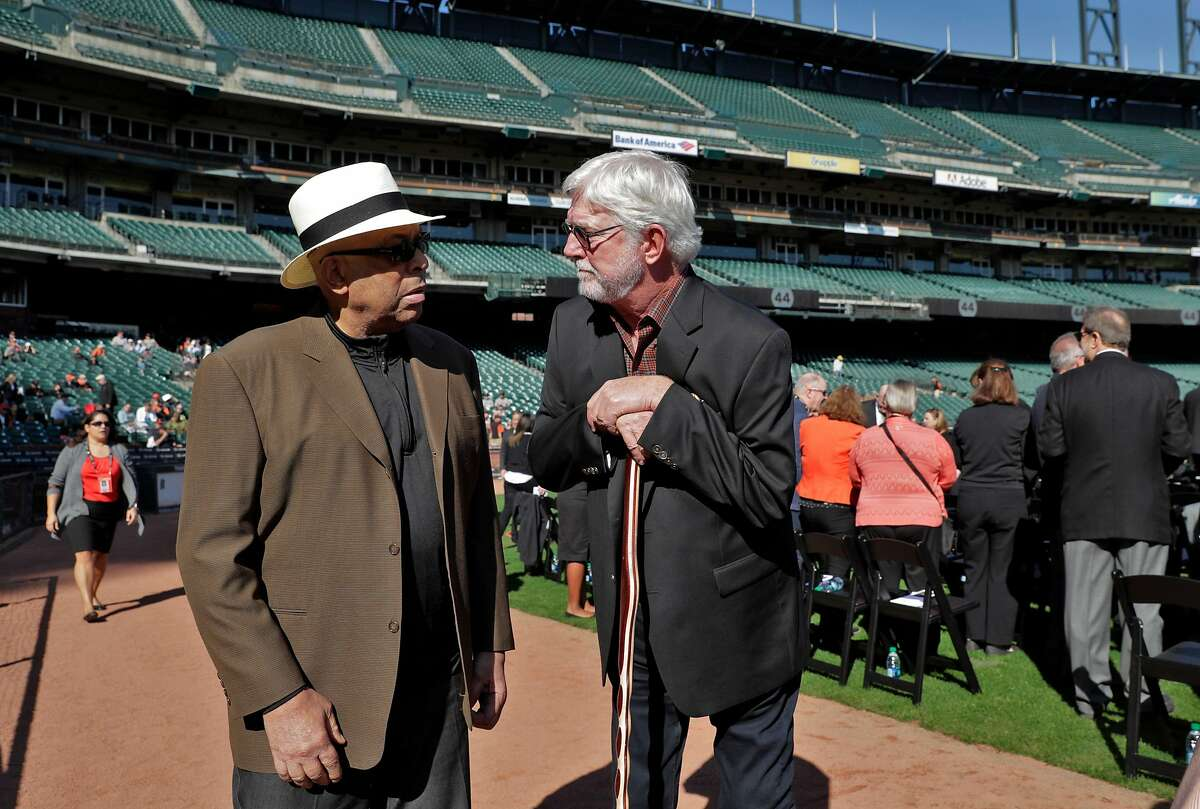 Giants announcer Mike Krukow chats with former teammate Orlando Cepeda during a public remembrance for Willie McCovey at AT&T Park in San Francisco, Calif., on Thursday, November 8, 2018.
