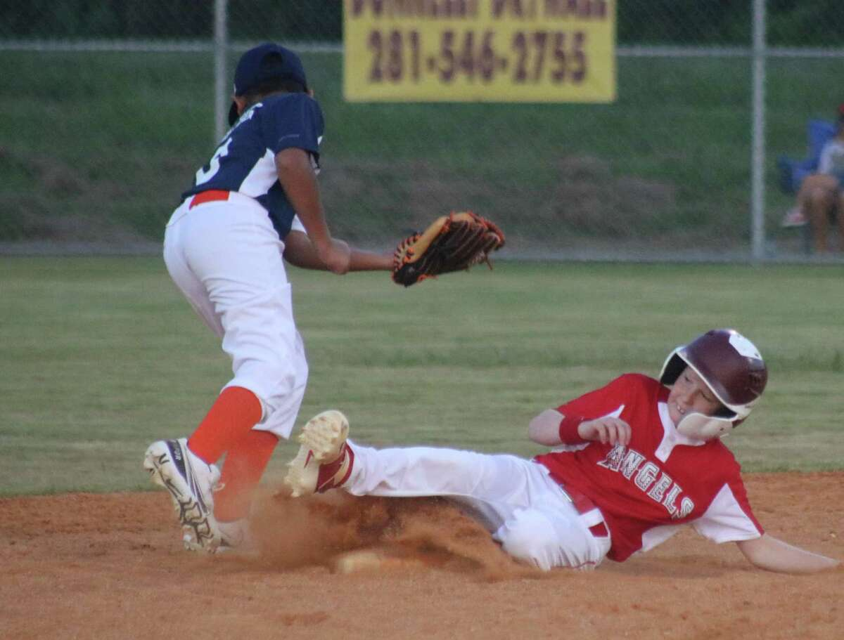 Angels runner Cody Hickman, one of the boys who competed at the Mustang 9s World Series last July, steals second base. It was one of four thefts by the team in the first inning.