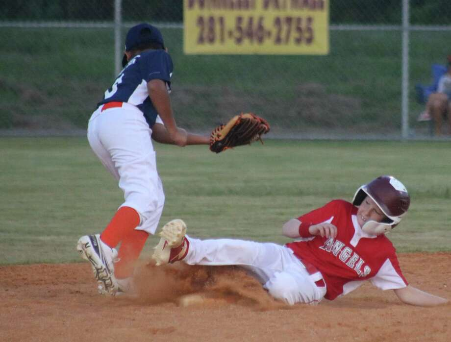 Angels runner Cody Hickman, one of the boys who competed at the Mustang 9s World Series last July, steals second base. It was one of four thefts by the team in the first inning. Photo: Robert Avery