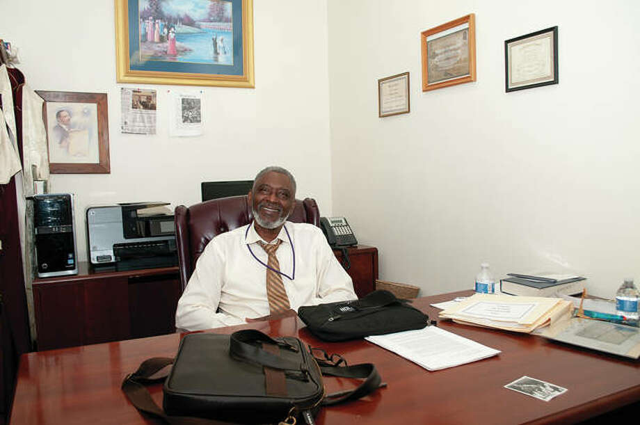 Samuel L. Holmes Sr., pastor at Jacksonville's Community Temple Church of God in Christ, sits in his office at the church. Holmes was arrested in 1965 while peacefully protesting for equal rights for black Americans. He was 15. Photo: Darren Iozia | Journal-Courier