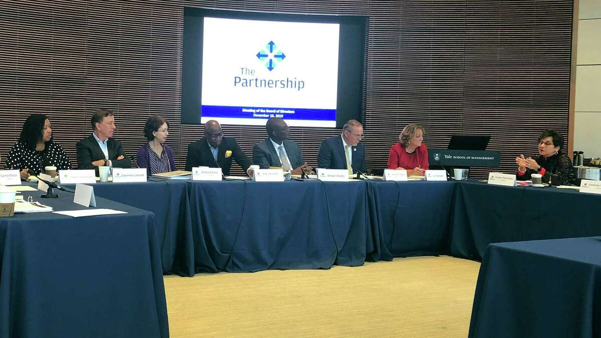 Yvette Melendez, right, addresses fellow members of The Partnership for Connecticut board of directors, including Gov. Ned Lamont, second from left, at the group's second meeting, held at Yale University, Monday, Dec. 16, 2019, in New Haven, Conn. The partnership is working to narrow the focus of the education nonprofit, which is funded partly by taxpayer funds and by contributions from Dalio Philanthropies, the family foundation of the founder of the world's largest hedge fund.