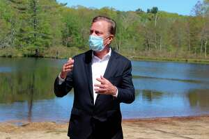 FILE - In this May 21, 2020, file photo, Connecticut Gov. Ned Lamont speaks to reporters at Gay City State Park in Hebron, Conn., updating the coronavirus situation in the state. A bipartisan group of Connecticut legislators gave the governor a list of issues to be reviewed in an upcoming, independent third-party investigation into the preparation and response to the coronavirus inside nursing homes and assisted living centers. (AP Photo/Pat Eaton-Robb, File)