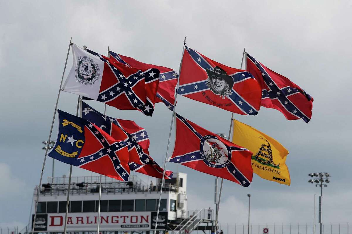 Confederate flags are seen flying over the infield campground prior to the NASCAR Sprint Cup Series Bojangles' Southern 500 at Darlington Raceway on Sept. 6, 2015 in Darlington, S.C. (Jerry Markland/Getty Images/TNS)