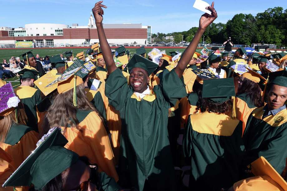 Graduation for the class of 2020 won't be quite the same as in 2018 but across the region drive-through ceremonies have brought smiles. Here. Sanjay Sutherland (center) waves to family during the Hamden High School commencement in 2019. Photo: Arnold Gold / Hearst Connecticut Media File / New Haven Register