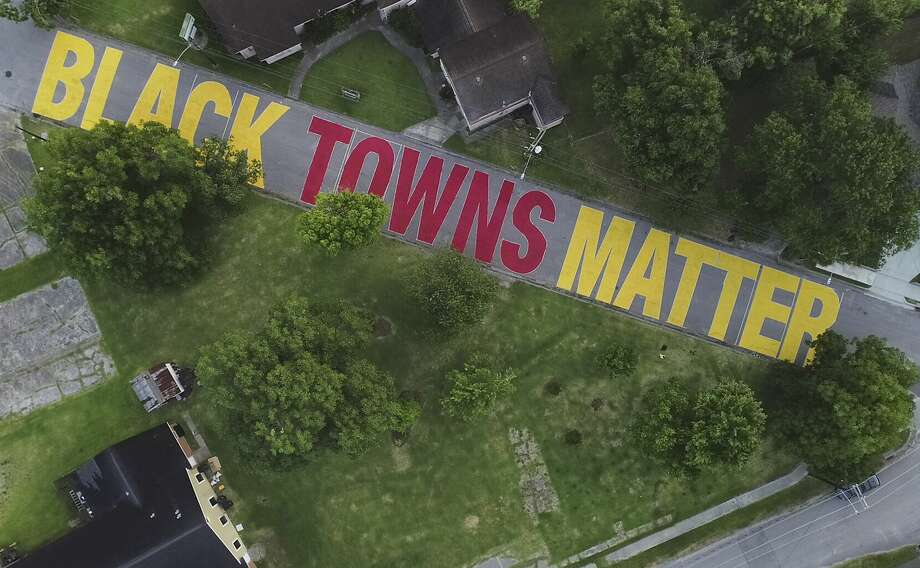 "Link Road in the Houston neighborhood of Independence Heights has ""Black Towns Matter"" painted on it in preparation for the community's Juneteenth celebration on Friday, June 19, 2020. Photo: Elizabeth Conley/Staff Photographer / © 2020 Houston Chronicle"