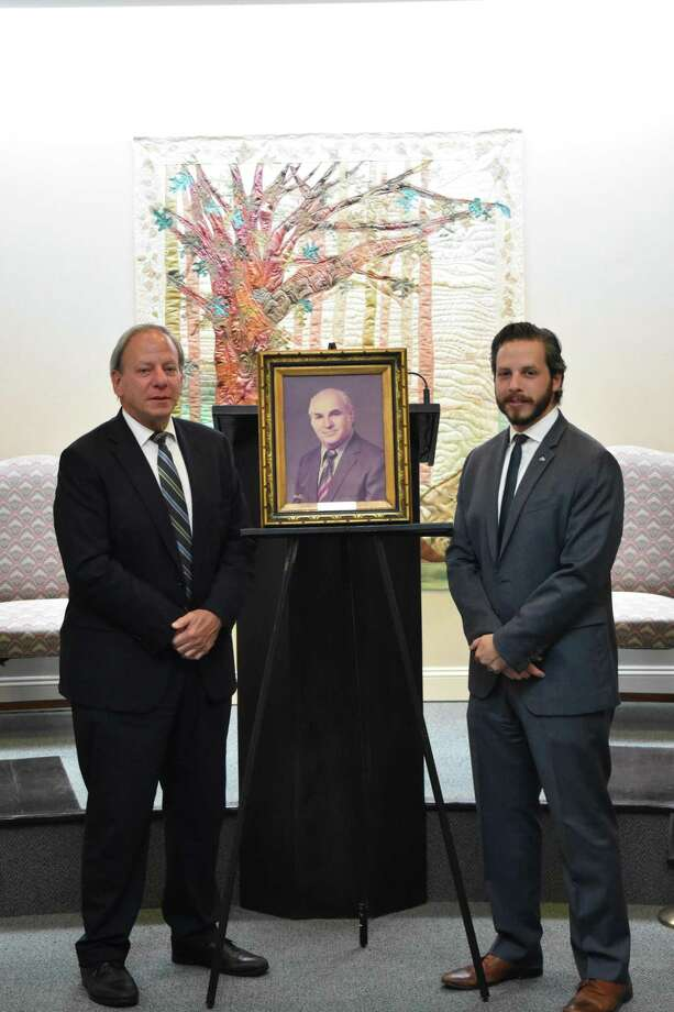 Samuel (son of the founder) and Jonathan (grandson of the founder). The portrait is of founder Abraham L. Green. Photo: / Contributed Photo