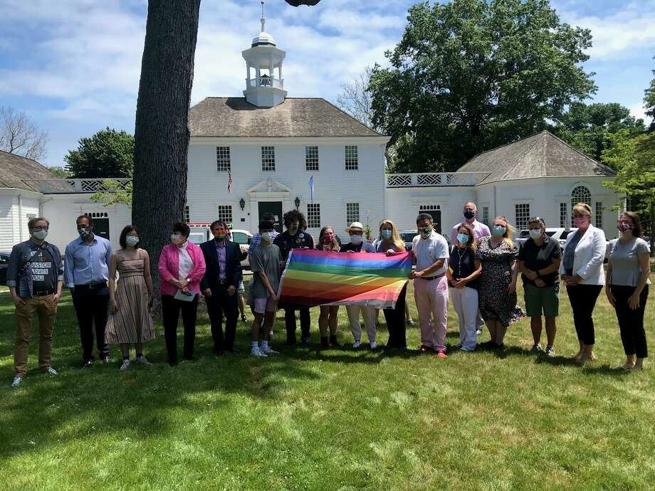 Fairfield's elected officials, community leaders and residents took part in a ceremony on Wednesday that marked the second time the pride flag was raised over a town property. Photo: Josh LaBella / Hearst Connecticut Media