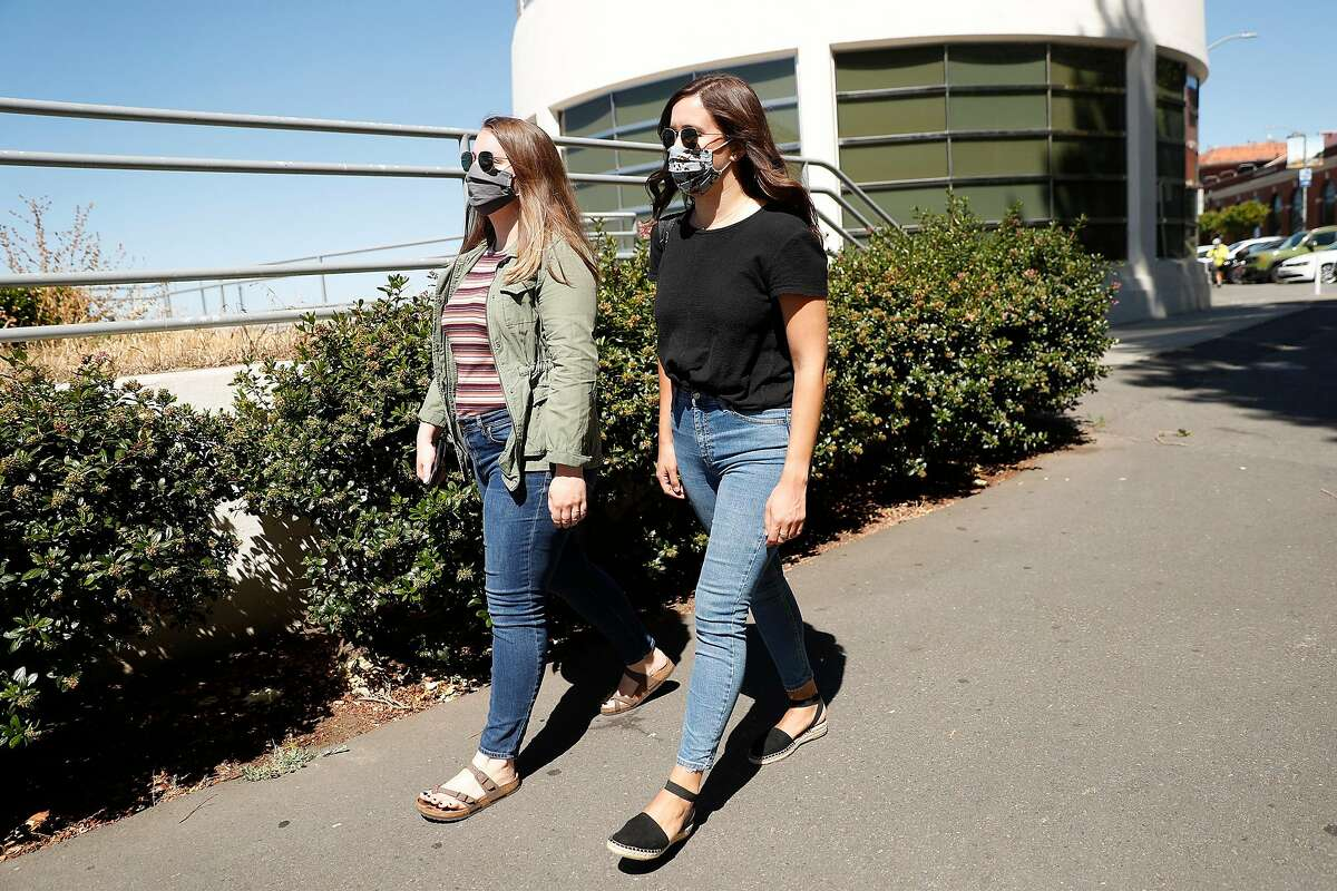 Laid off tech worker Amanda Heath (right) and her roommate, Ellen McFadden, at Aquatic Park in San Francisco, Calif., on Wednesday, June 17, 2020.