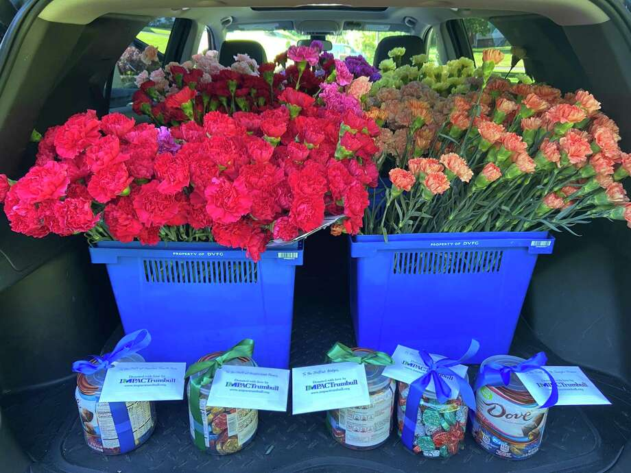 IMPACTrumbull, a local 501c3 in Trumbull that completes monthly community service projects, recently donated 1,200 carnations to the residents of all five nursing care facilities in Trumbull: Spring Meadows, Middlebrook Farms, Genesis St. Joseph's Manor, Maefair Healthcare, and EPOCH by Bridges, receiving a generous discount from City Line Florist and were able to donate a pair of carnations to all 600 residents.In addition, IMPACTrumbull sponsored a 5th round of collecting donations from the community, receiving more than $1,700 in donations from Trumbull residents and used that money to purchase gift cards to J Bagels, Old Towne Restaurant and Trumbull Pizza Company so that every shift at all five facilities would receive a meal. Gift cards were attached to canisters of chocolates for the staff lounges. Photo: Contributed Photo