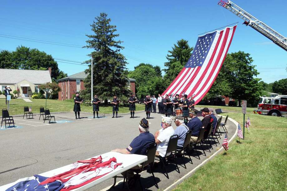 Members of the Elks Lodge 771 in Middletown conducted a Flag Day ceremony Sunday at the 44 Maynard St. facility during which Mayor Ben Florsheim gave a patriotic speech. South Fire District personnel displayed the department's giant American flag during the proceedings, and the Middletown Police Benefit Association Bagpipe Band played throughout the ceremony. The Daughters of American Veterans Chapter 7 presented a ceremonial burning of the flag strips, representing the original 13 states. Photo: Jerry Augustine Photo