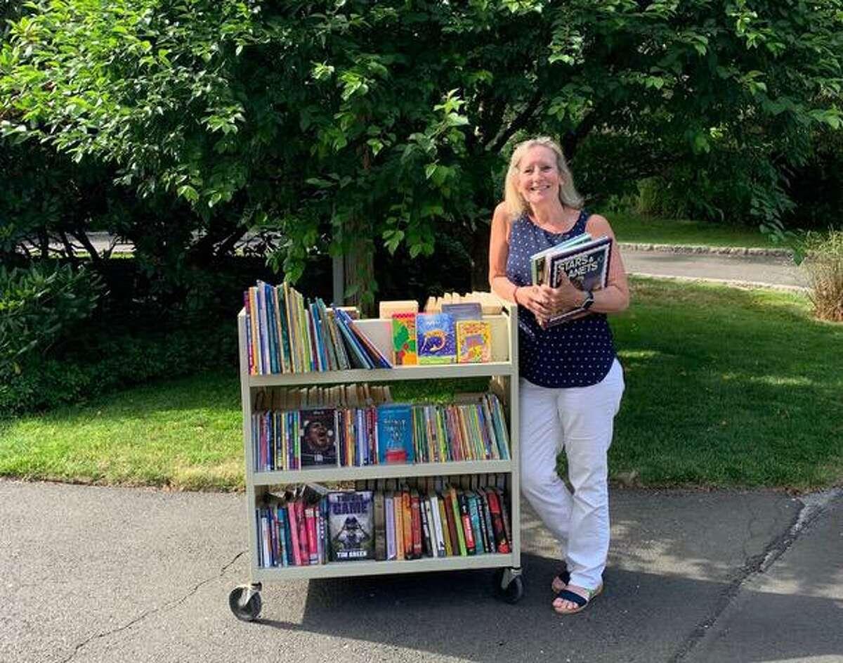 Greenwich resident Lorrie Stapleton is a volunteer at Darien Book Aid.