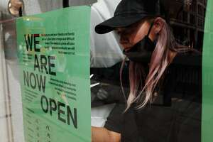 Worker reopens business due to COVID-19 shutdown.