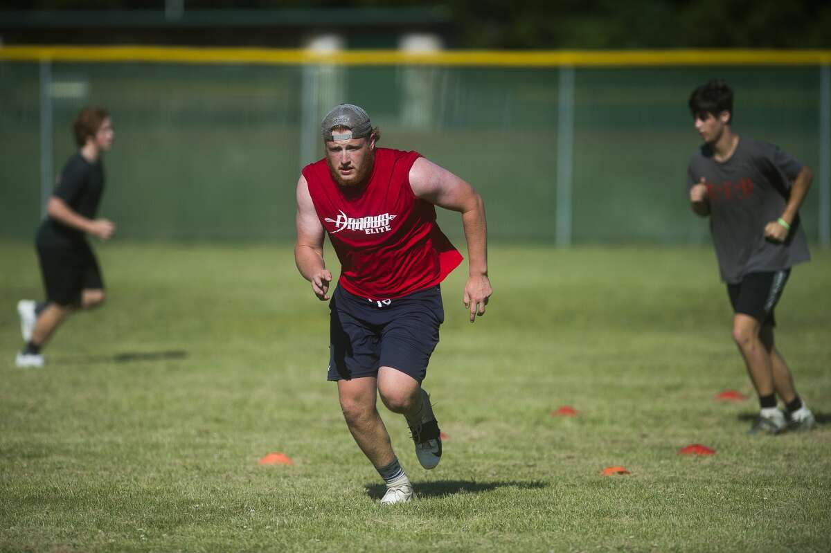 Caleb Brenske completes a drill during a Dow High football practice Thursday, June 18, 2020 at the school. (Katy Kildee/kkildee@mdn.net)