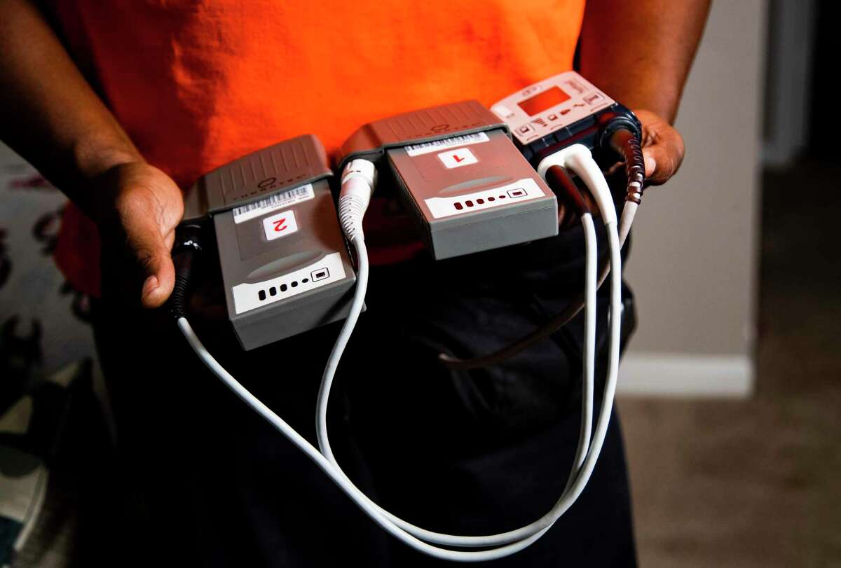 Tyrone Morris, 43, a congestive heart failure patient waiting for a heart transplant in Humble, shows the batteries that keeps a HeartMate III working for his heart on Wednesday, June 17, 2020, in Humble. HeartMate III is a heart pump system that keeps him alive while he waits for a heart transplant.