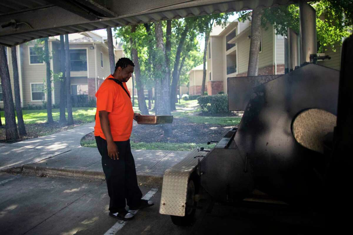 Tyrone Morris, 43, grills ribs on an industrial size griller on Wednesday, June 17, 2020, in Humble. Morris is a restaurant owner, a caterer, a husband, a father, an avid sports enthusiast and a patient of congestive heart failure. Morris has been living in Houston for four months waiting for a heart transplant.