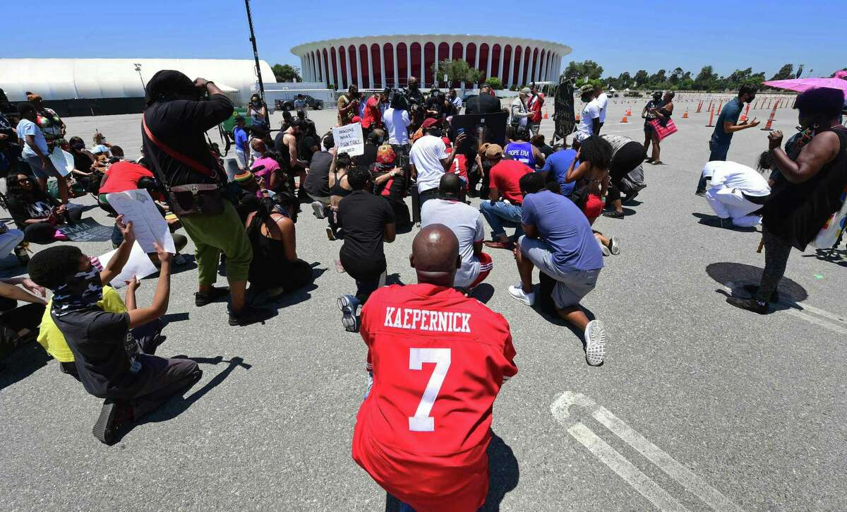 Protesters call on the NFL to apologize to Colin Kaepernick during a June 11 demonstration in Inglewood, Calif.