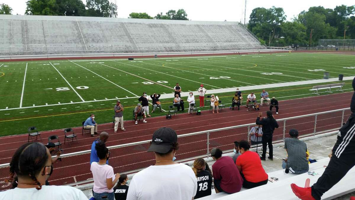 The Bridgeport City Council, on the track, and members of the community, in the stands, wrap up a public hearing on police reform at Kennedy Stadium on June 18, 2020.