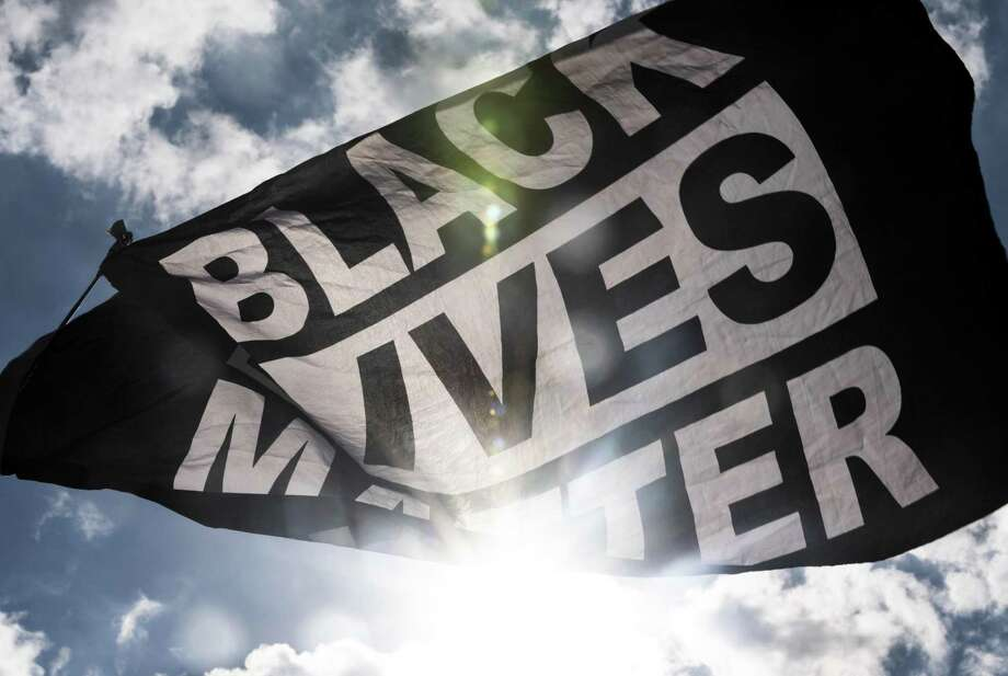 A Black Lives Matter flag, seen here in a file photo, flew over the State Capitol in Hartford on Friay as Senate Democrats announced an ambitious set of goals for a special session next month, including law enforcement oversight, educational, housing and economic initiatives. Photo: Stephen Maturen / Getty Images / 2020 Getty Images