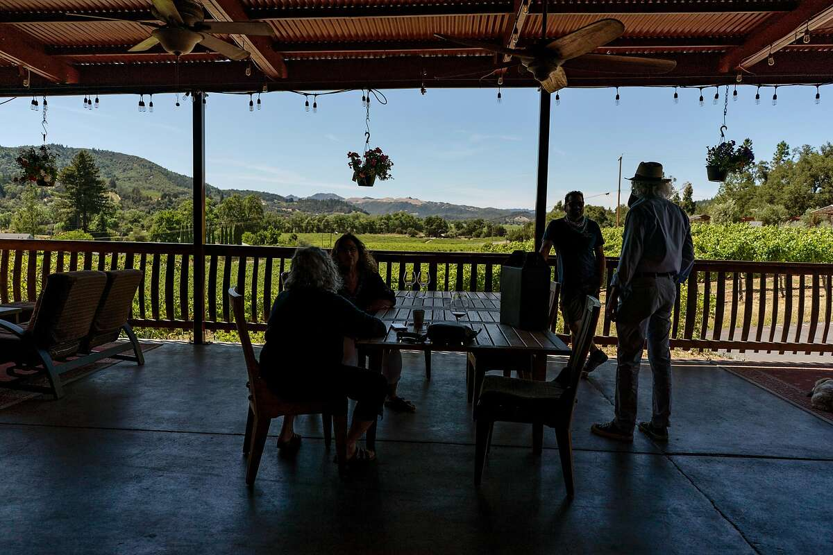Customers taste wine at the Papapietro Perry Winery now that it has reopened its doors. Healdsburg, California on June 18, 2020.