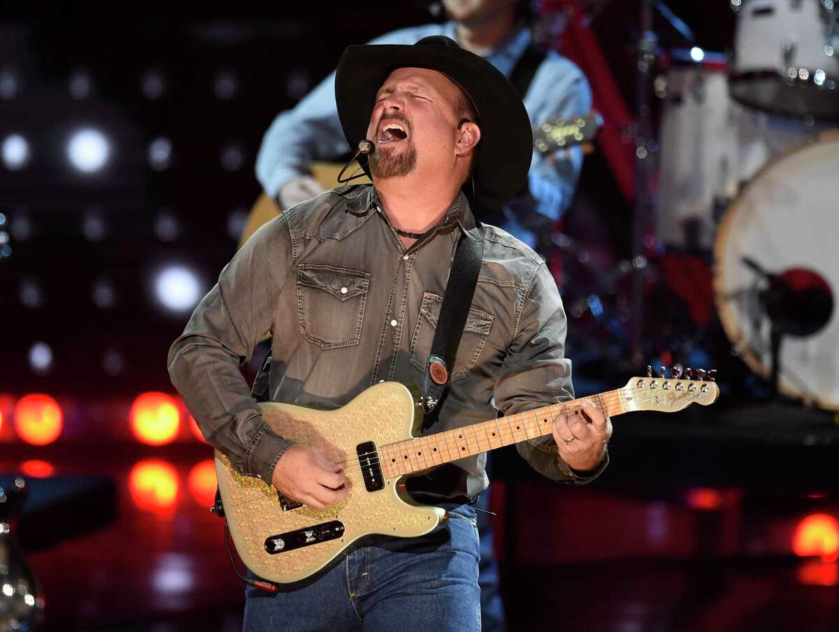 FILE - This March 14, 2019 file photo shows Garth Brooks performing at the iHeartRadio Music Awards in Los Angeles. Brooks is holding a concert in Nashville,Tenn., that will be played at 300 drive-in theaters across the country. Tickets will cost $100 per passenger car or truck. (Photo by Chris Pizzello/Invision/AP, File)