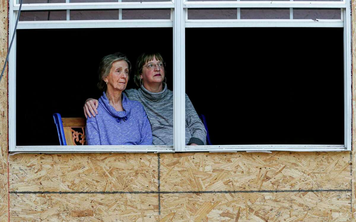 Tracy Stephenson, right, and her mother, Karon Maples, pose for a photograph inside their home, which is being rebuilt after it was knocked off its foundation by an explosion at nearby Watson Grinding and Manufacturing earlier this year, on Thursday, May 7, 2020, in Houston.