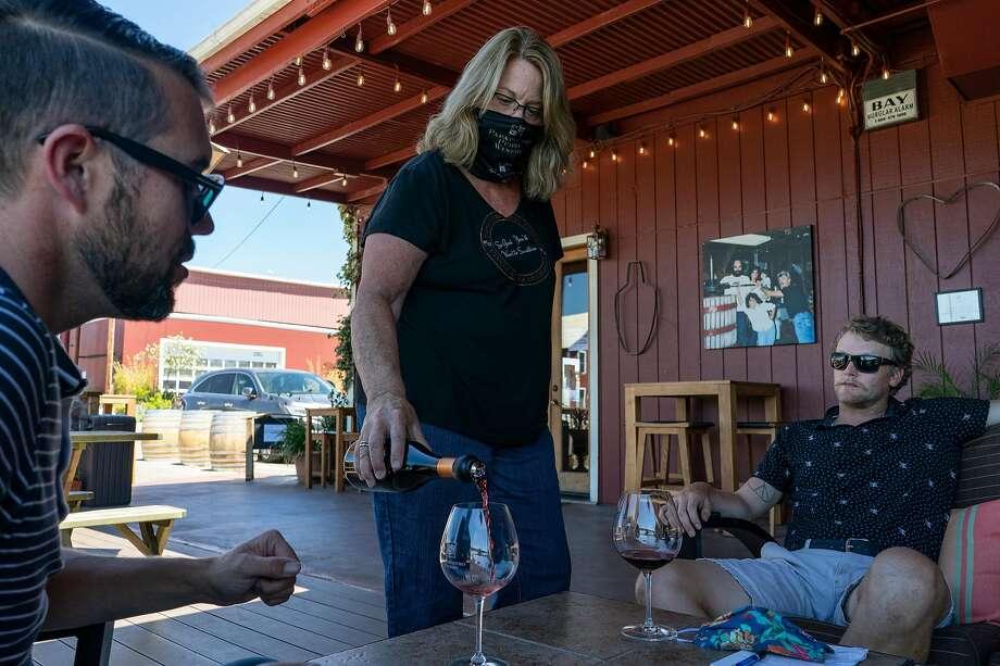 Nancy Juarez pours wine for customers. Photo: Rachel Bujalski / Special To The Chronicle