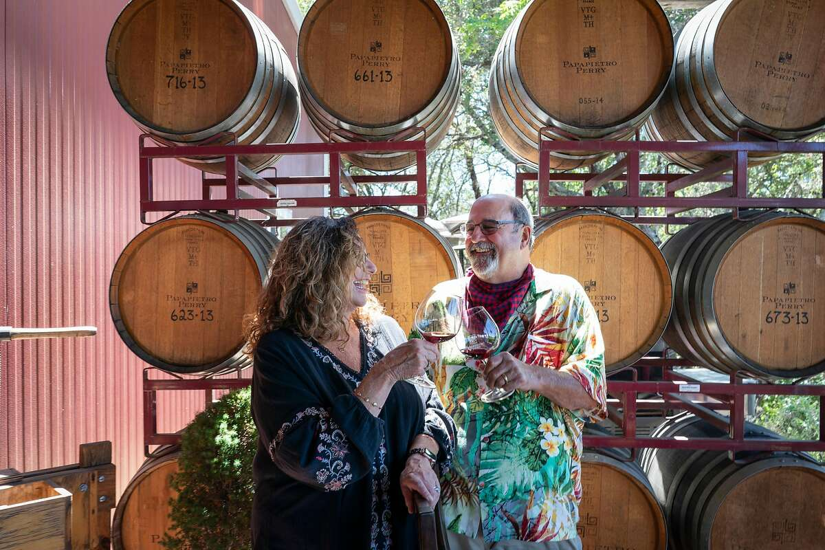 Co-owners Ben Papapietro and Renae Perry sit outside on the tasting deck that overlooks the vineyards at the Papapietro Perry Winery now that it has reopened its doors. Healdsburg, California on June 18, 2020.