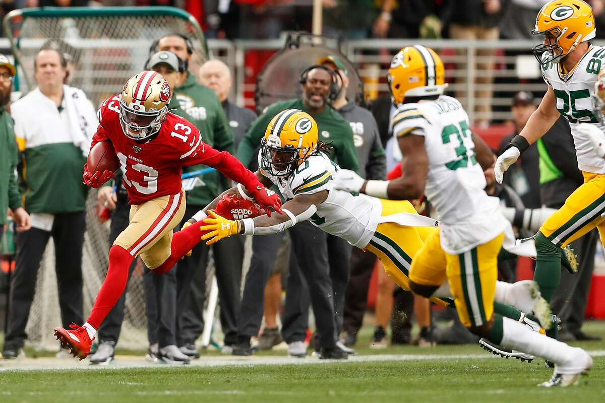 San Francisco 49ers' Richie James gets past Green Bay Packers' Jamaal Williams in the first quarter during the NFC Championship game between the San Francisco 49ers and the Green Bay Packers at Levi's Stadium on Sunday, Jan. 19, 2020 in Santa Clara, Calif.