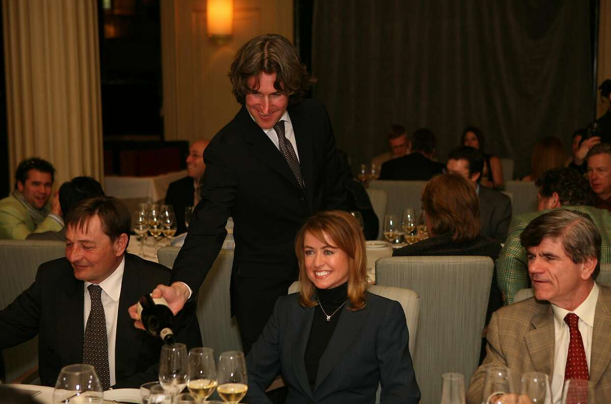 Richard Betts (standing) pours wine for guests (left to right) Dominique Lafon, Deborah Senior and George Borst at the La Poulee de San Francisco 2008 -- a celebration of burgundy wine where 50 elite guests will taste the newest releases and older vintage wines of the growers from over twenty five of the most sought after domaines of Burgundy. The event was held Thursday, Feb. 27, 2008 at the Westin St. Francis in Michael Mina's restaurant. Thor Swift For The San Francisco Chronicle