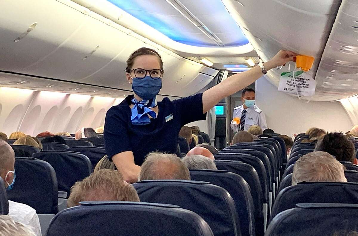 A flight attendant gives safety instructions prior to the departure of a flight from Dusseldorf, Germany, on June 15.