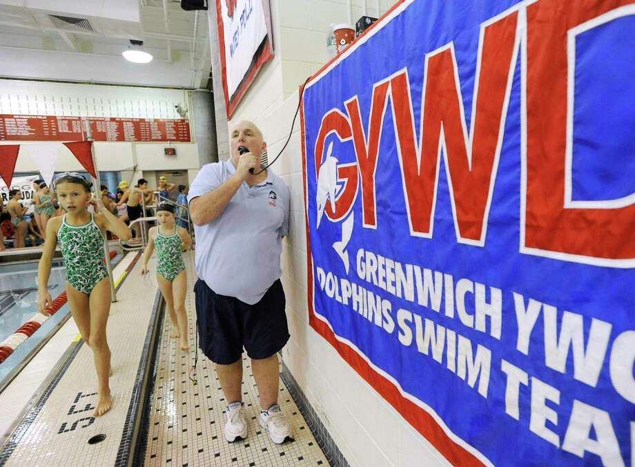Nick Cavataro, right, head swim coach of the YWCA of Greeenwich. Photo: Hearst Connecticut Media / Greenwich Time