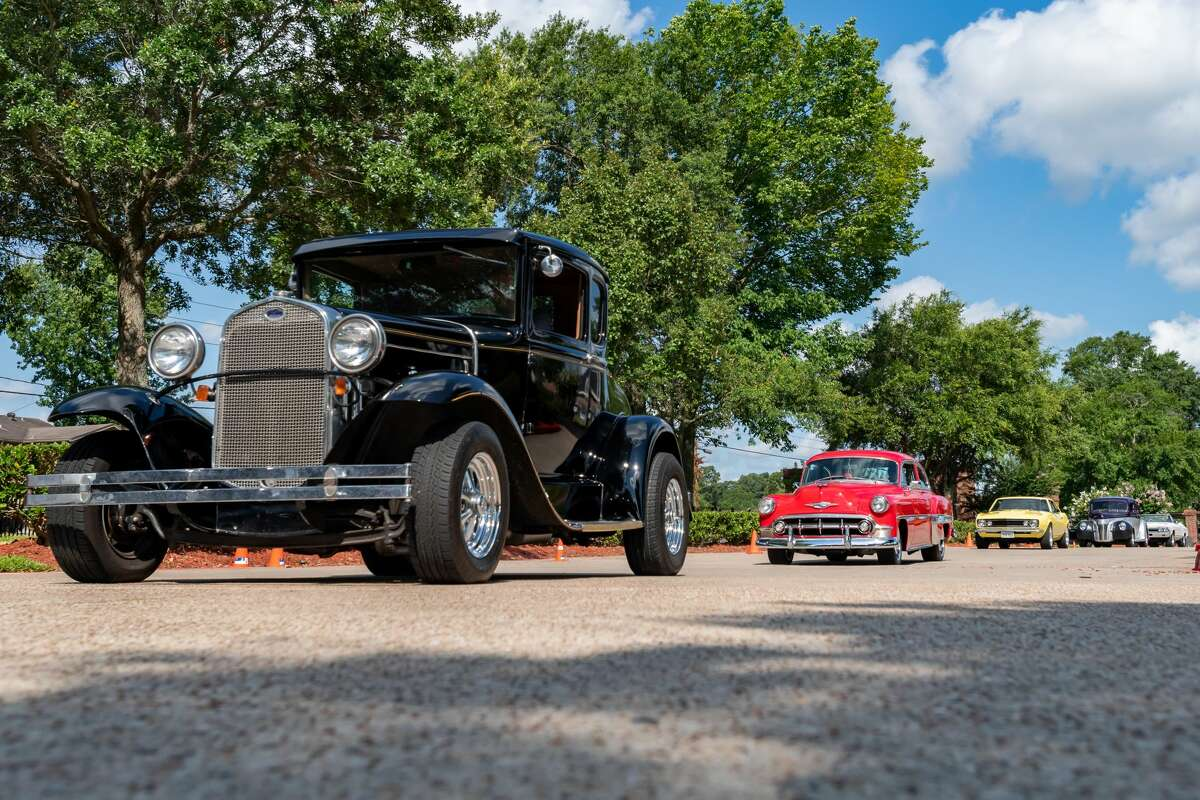 Calder Woods held their Father's Day classic car show on Friday morning, only this time it was a drive-thru parade of the classic cars through the grounds of the facility as the residents and staff watched. Photo made on June 19, 2020. Fran Ruchalski/The Enterprise