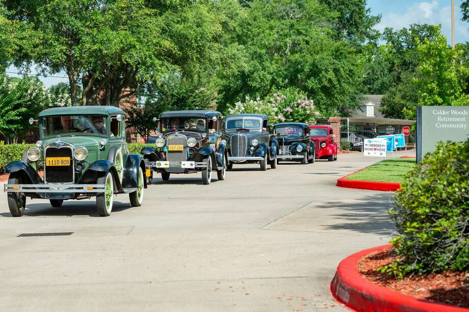 Calder Woods held their Father's Day classic car show on Friday morning, only this time it was a drive-thru parade of the classic cars through the grounds of the facility as the residents and staff watched. Photo made on June 19, 2020. Fran Ruchalski/The Enterprise Photo: Fran Ruchalski/The Enterprise / © 2020 The Beaumont Enterprise