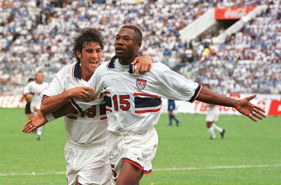 United States forward Jovan Kirovski, left, hugs teammate Roy Lassiter after Lassiter's goal during a World Cup qualifying match against El Salvador in San Salvador, El Salvador on Sunday, June 29, 1997. Lassiter played for the Laredo Heat during their inaugural season. Photo: Luis Romero / Associated Press File / AP