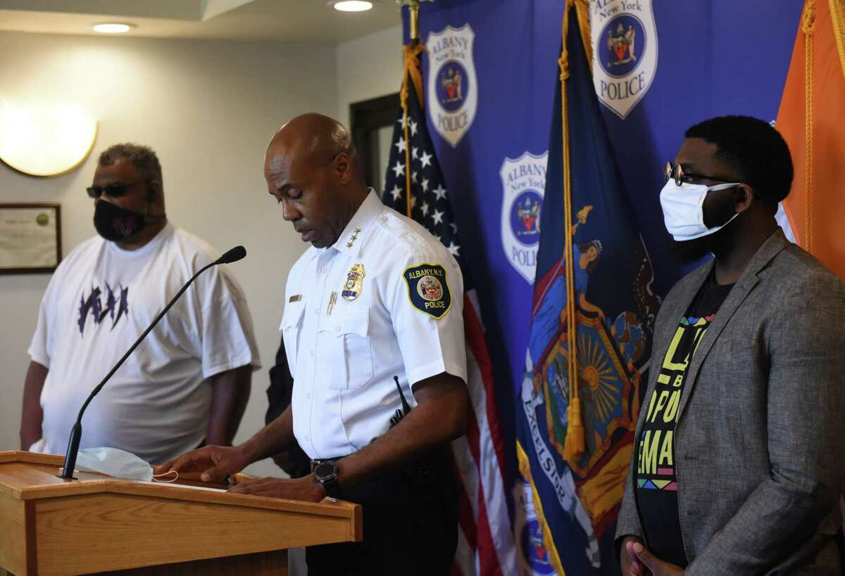 Albany Police Chief Eric Hawkins, flanked by Albany Councilmen Derek Johnson, left, and Jahmel Robinson, right, comments on the city's recent wave of shootings on Friday, June 19, 2020, during a press conference at police headquarters in Albany, N.Y. (Will Waldron/Times Union)