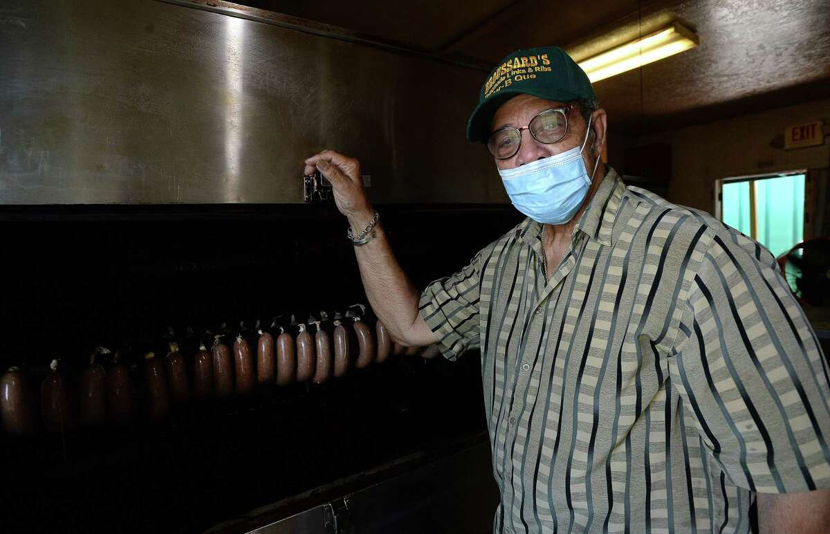 Leonard Broussard stands by a smoker at Broussard's BBQ in Beaumont. Broussard started the business 27 years ago, and has been a go-to for barbecue since. Broussard has been reacing out to to help those in need, making weekly deliveries every Saturday to various homeless camps and other spots. Photo taken Wednesday, June 17, 2020 Kim Brent/The Enterprise