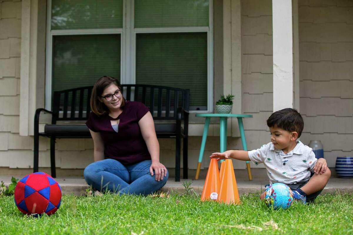 Nathan DeKing, 2, and his mother, Sarah Pollock, play on June 18, 2020.