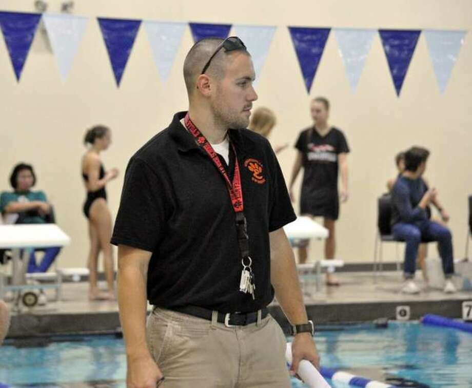 Coach Christian Rhoten and the Edwardsville girls swim started lap swimming this week at Chuck Fruit Aquatic Center, which reopened after being closed for three months. Photo: Intelligencer Sports Staff
