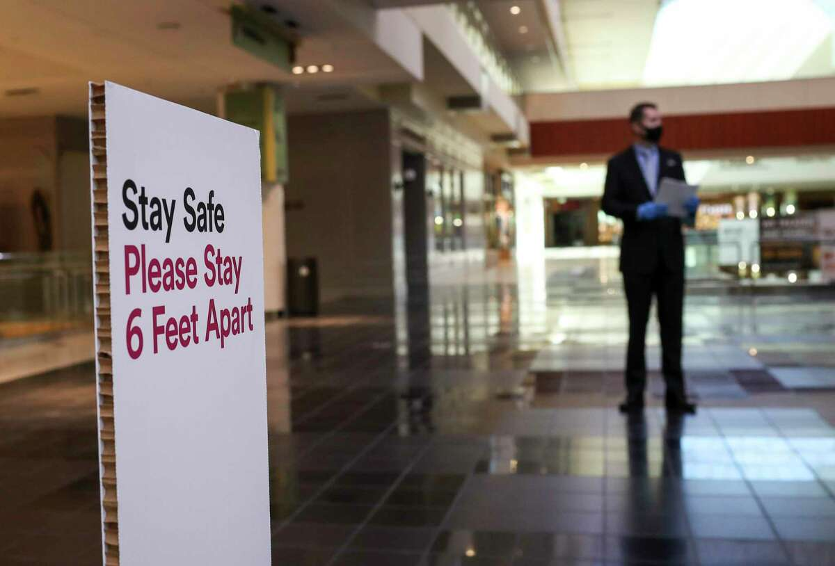 Kurt Webb, mall manager of the Galleria, shown near social distancing guidelines at the mall before it reopens Friday, May 1, 2020, in Houston. The Galleria is one of three malls owned by Simon Property in Houston.