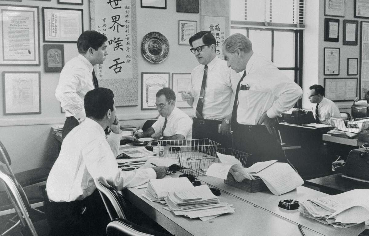 (Original Caption) In an improvised newsroom at the New York Times, editors work on a pilot issue of a New York afternoon newspaper. The paper is being edited by Times Assistant Managing Editor A.M. Rosenthal, (standing at center, wearing glasses), with a temporary staff drawn from the Times. From left are James Greenfield, (seated; Michael Levitas; Henry Lieberman; Rosenthal, and Larry Hauck. The Times had made no decision on whether to publish the newspaper.