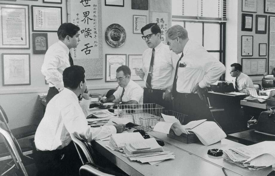 (Original Caption) In an improvised newsroom at the New York Times, editors work on a pilot issue of a New York afternoon newspaper. The paper is being edited by Times Assistant Managing Editor A.M. Rosenthal, (standing at center, wearing glasses), with a temporary staff drawn from the Times. From left are James Greenfield, (seated; Michael Levitas; Henry Lieberman; Rosenthal, and Larry Hauck. The Times had made no decision on whether to publish the newspaper. Photo: Bettmann/Bettmann Archive