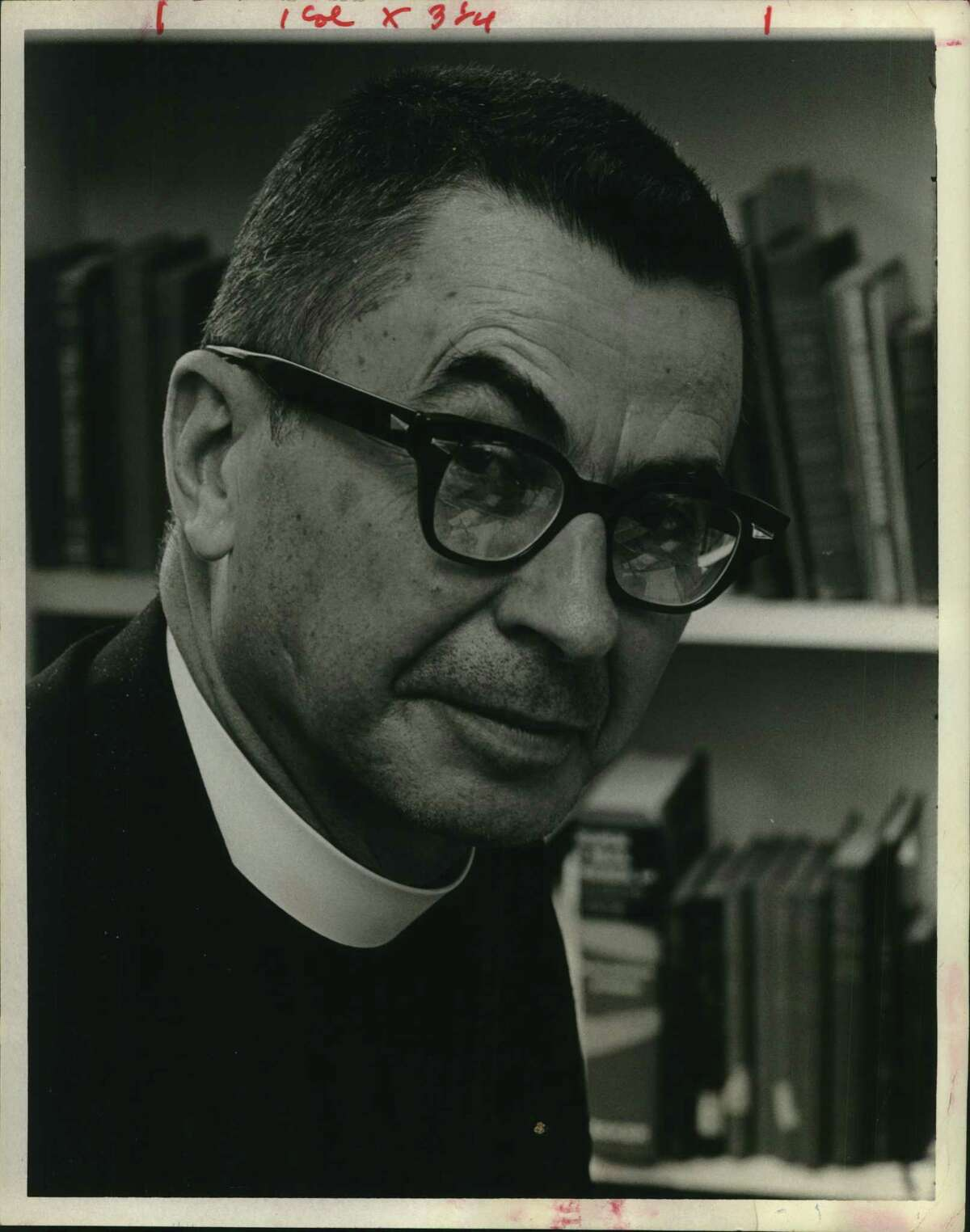 St. Thomas' Episcopal School alumni are calling for a deeper reckoning with the segregationist beliefs of founding rector Rev. T. Robert Ingram, pictured, who helped start the Meyerland church in the 1950s. St. Thomas' Episcopal administrators this month called Ingram's beliefs
