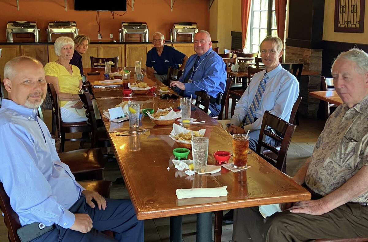 Members of the Conroe Noon Kiwanis Club are pictured at their meeting on June 17. The club will begin meeting weekly again on July 1.