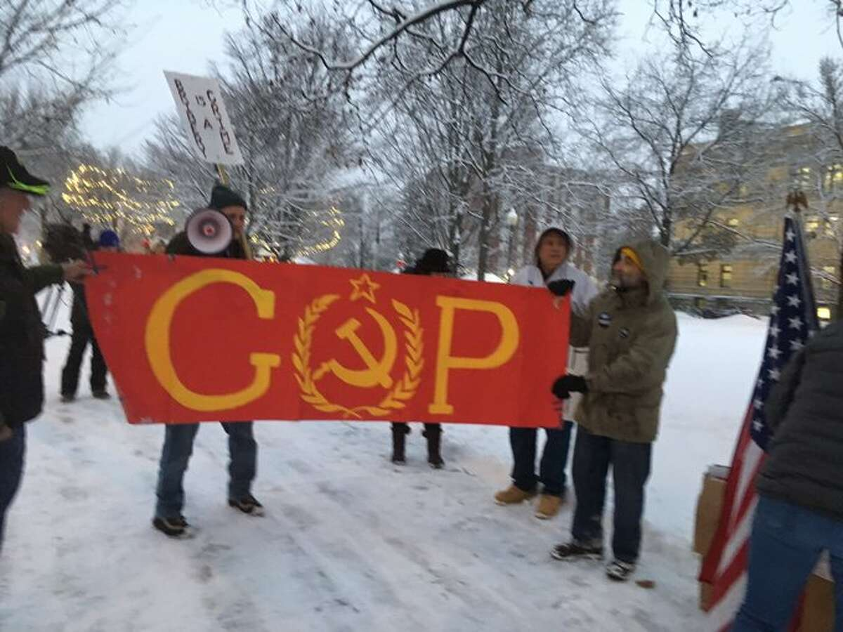 About 75 pro-impeachment protesters get ready to march in City Park on Tuesday, Dec. 17, in Glens Falls, N.Y.
