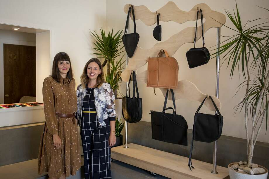 Kim Schnaubert and Lisa Brazile pose by Permian handbags Thursday, June 18, 2020 at Brazile's home in Odessa. Photo: Jacy Lewis/Reporter-Telegram / Jacy Lewis/Reporter-Telegram
