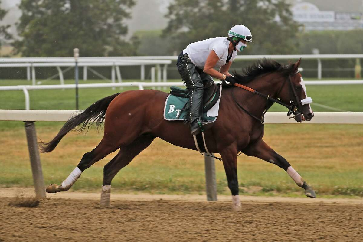 Robin Smullen rides Tiz the Law during a workout at Belmont Park in Elmont, N.Y., Friday, June 19, 2020. (AP Photo/Seth Wenig)