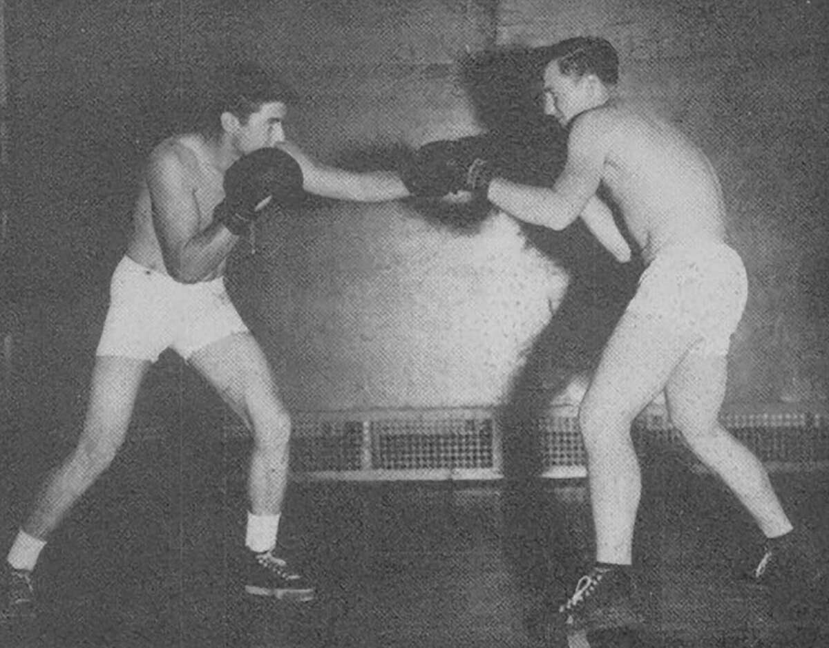 Woodman takes on Bruce in boxing as a part of Conroe High School's boxing program in the 1946-47 school year.